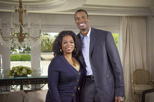 "Photo - This May 1, 2013 photo released by OWN shows host Oprah Winfrey posing with NBA  basketball player Jason Collins during an interview for ""Oprah's Next Chapter,"" in Beverly Hills, Calif.  The interview aired Sunday. Officials at three publishing houses said Monday, May 6, that they had been contacted about a planned memoir by Collins, the first active player in any of four major U.S. professional sports leagues to come out as gay.  (AP Photo/OWN, Chuck Hodes)"