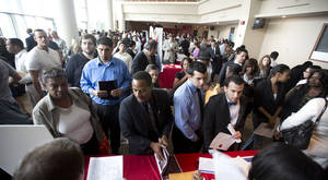 photo - In this Tuesday, Jan. 22, 2013 photo, job seekers fill a room at the job fair in Sunrise, Fla. U.S. employers added 157,000 jobs in January, and hiring was much stronger at the end of 2012 than previously thought, providing reassurance that the job market held steady even as economic growth stalled, according to Labor Department reports, Friday, Feb. 1, 2013. (AP Photo/J Pat Carter)