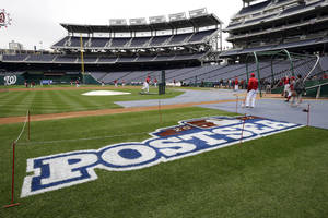 photo -   Washington Nationals players take batting practice at Nationals Park, Tuesday, Oct. 9, 2012, in Washington. The Nationals are scheduled to host the St. Louis Cardinals in Game 3 of the National League division series on Wednesday. The best-of-five games series is tied 1-1. (AP Photo/Alex Brandon)