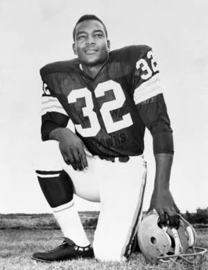 Photo -   FILE - This undated file photo shows Cleveland Browns running back Jim Brown posing for a team photo. Jim Brown and the Cleveland Browns are getting back together. The Hall of Fame running back, who has had a rift with his former team for several years, plans to take part in alumni events this weekend when the Browns host the Buffalo Bills on Sunday, Sept. 23, 2012. (AP Photo/File)