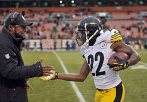 Photo - Pittsburgh Steelers cornerback William Gay (22) is congratulated by head coach Mike Tomlin after Gay returned an interception 21 yards for a touchdown against the Cleveland Browns in the fourth quarter of an NFL football game Sunday, Nov. 24, 2013. (AP Photo/David Richard)