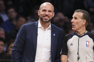 Photo - Brooklyn Nets head coach Jason Kidd smiles during the second half of their NBA basketball game against the Houston Rockets at the Barclays Center, Tuesday, April 1, 2014, in New York. (AP Photo/John Minchillo)