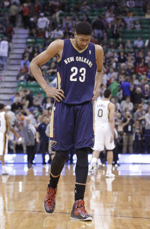 Photo - New Orleans Pelicans' Anthony Davis walks off the court at the end of the first half of the Pelicans' NBA basketball game against the Utah Jazz on Friday, April 4, 2014, in Salt Lake City. The Jazz won 100-96. (AP Photo/Rick Bowmer)