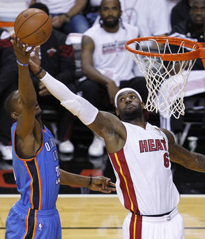 Photo -   Miami Heat small forward LeBron James (6) shoots as Oklahoma City Thunder small forward Kevin Durant (35) defends during the first half at Game 3 of the NBA Finals basketball series, Sunday, June 17, 2012, in Miami. (AP Photo/Wilfredo Lee)