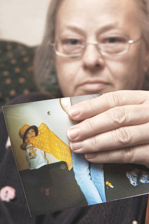 photo - Dewanna Cleary holds a photo of her grandson John Brian  Gifford, 5, who died Tuesday.  Photo BY DOUG HOKE, THE OKLAHOMAN