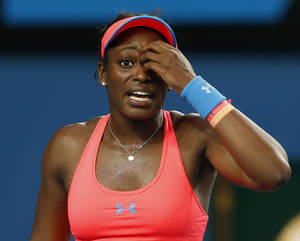 Photo - Sloane Stephens of the U.S. reacts during her second round match against Ajla Tomljanovic of Croatia at the Australian Open tennis championship in Melbourne, Australia, Thursday, Jan. 16, 2014.(AP Photo/Eugene Hoshiko)