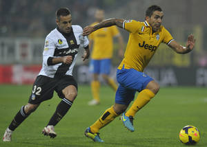 Photo - Parma's Marco Marchionni, left,  chases Juventus' Carlos Tevez during their Serie A soccer match at Parma's Tardini stadium, Italy, Saturday, Nov. 2, 2013. (AP Photo/Marco Vasini)