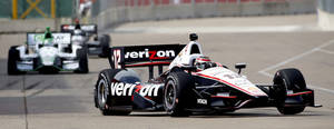 Photo - Will Power, of Australia, drives through the course during a practice session for the IndyCar Grand Prix of Houston auto race Friday, June 27, 2014, in Houston. (AP Photo/David J. Phillip)