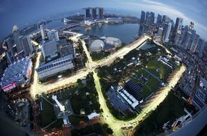 Photo - A birdeye view of the Singapore F1 Grand Prix's Marina Bay City Circuit, shot with a fish-eye lens, is seen at dusk from Swissotel The Stamford in Singapore, Tuesday, Sept. 17, 2013. The race is slated for September 21-23. (AP Photo/Wong Maye-E)