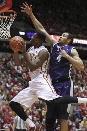 Photo - Iowa State forward Melvin Ejim (3) goes around TCU forward Amric Fields (4) as he goes up for a shot during the first half of an NCAA college basketball game at Hilton Coliseum in Ames, Iowa, Saturday, Feb. 8, 2014. (AP Photo/Justin Hayworth)