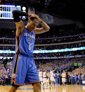 photo - Oklahoma City's Russell Westbrook (0) reacts in the final minutes of Oklahoma City's loss in game 5 of the Western Conference Finals in the NBA basketball playoffs between the Dallas Mavericks and the Oklahoma City Thunder at American Airlines Center in Dallas, Wednesday, May 25, 2011. Photo by Bryan Terry, The Oklahoman