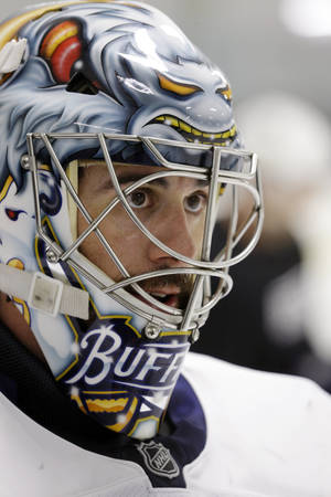 photo - Buffalo Sabres goalie Ryan Miller looks on during an informal NHL hockey workout in Amherst, N.Y., Friday, Jan. 11, 2013. (AP Photo/David Duprey)