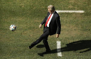 Photo - Switzerland's coach Ottmar Hitzfeld kicks a ball during the World Cup round of 16 soccer match between Argentina and Switzerland at the Itaquerao Stadium in Sao Paulo, Brazil, Tuesday, July 1, 2014. (AP Photo/Thanassis Stavrakis)
