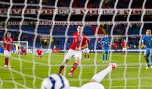 Photo -   Norway's John Arne Riise scores a goal as Norway play Slovenia in FIFA World Cup 2014 qualifier Group E Match which ended 2 - 1, in Oslo, Norway, Tuesday, Sept. 11, 2012. (AP Photo/Vegard Grott / NTB scanpix) NORWAY OUT