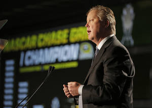 Photo - NASCAR CEO Brian France talks to the media about the new points system during a news conference at the NASCAR Sprint Cup auto racing Media Tour in Charlotte, N.C., Thursday, Jan. 30, 2014. (AP Photo)