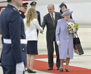 Photo - Queen Elizabeth II, accompanied by Prince Philip arrives at Rome's Ciampino military airport to start their one-day visit to Italy and the Vatican, Thursday, April 3, 2014. The British Royals will meet Italian President Giorgio Napolitano during an official lunch at the Quirinale Presidential Palace and Pope Francis at the Vatican in the afternoon. (AP Photo/Daniele Leone) Photo LaPresse 04-03-2014 Rome (Italy) News Queen Elizabeth and Prince Philip arrive at Ciampino airport