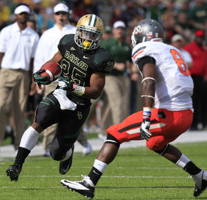 Photo - Baylor running back Lache Seastrunk (25) runs against Oklahoma State safety Daytawion Lowe (8) during the first half of an NCAA college football game, Saturday, Dec. 1, 2012, in Waco, Texas. (AP Photo/LM Otero)