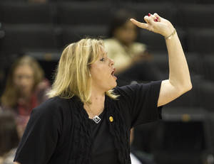 photo - Wake Forest coach Jen Hover directs her team against Maryland during the first half of an NCAA college basketball game in Winston-Salem, N.C., Friday, Feb. 8, 2013. Maryland won 73-63. (AP Photo/Lynn Hey)