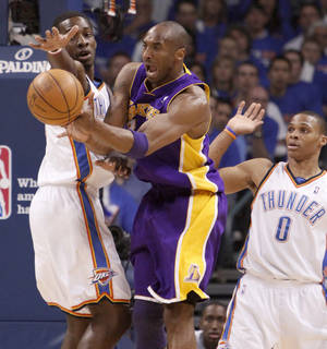 Photo - L.A.'s Kobe Bryant passes the ball from between Oklahoma City's Jeff Green, left, and Russell Westbrook  during the NBA basketball game between the Los Angeles Lakers and the Oklahoma City Thunder in game six of the first round series at the Ford Center in Oklahoma City, Friday, April 30, 2010. Photo by Bryan Terry, The Oklahoman