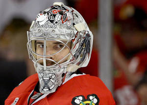 Photo - Chicago Blackhawks goalie Corey Crawford (50) takes break during a time out during Game 2 of the NHL hockey Stanley Cup Finals against the Boston Bruins, Saturday, June 15, 2013, in Chicago. (AP Photo/Nam Y. Huh)