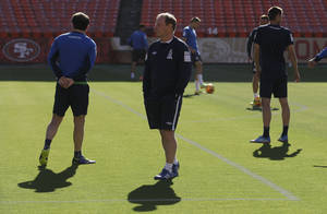 Photo - Azerbaijan soccer head coach Berti Vogts, center, watches as his team begins practice at Candlestick Park in San Francisco, Sunday, May 25, 2014. (AP Photo/Jeff Chiu)