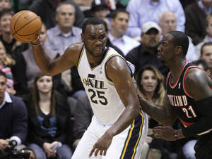 Photo -   Portland Trail Blazers forward J.J. Hickson (21) defends Utah Jazz center Al Jefferson (25) during the first quarter of a preseason NBA basketball game Thursday, Oct. 25, 2012, in Salt Lake City. (AP Photo/Rick Bowmer)