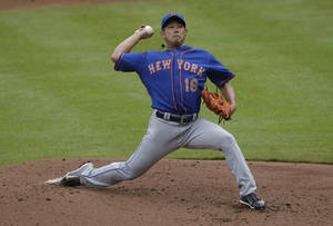 Photo - New York Mets starting pitcher Daisuke Matsuzaka (16) works in the first inning of a baseball game against the Atlanta Braves, Monday, Sept. 2, 2013 in Atlanta. (AP Photo/John Bazemore)