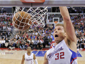 Photo - Los Angeles Clippers forward Blake Griffin dunks as guard Chris Paul watches during the second half of their NBA basketball game against the Memphis Grizzlies, Saturday, March 24, 2012, in Los Angeles. The Clippers won 101-85. (AP Photo/Mark J. Terrill) ORG XMIT: LAS105