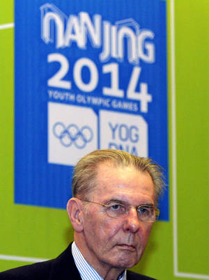 Photo - International Olympic Committee President Jacques Rogge attends a press conference Tuesday, Jan 29, 2013 in Nanjing, the host city of the 2nd Summer Youth Olympic Games to be held in 2014 in eastern China's Jiangsu province. (AP Photo) CHINA OUT