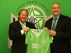 Photo -  Tim McLaughlin, left, is introduced by Bob Funk Jr. as a new partner with the Oklahoma City Energy FC. Photo by Chris Brannick, The Oklahoman     <strong></strong>