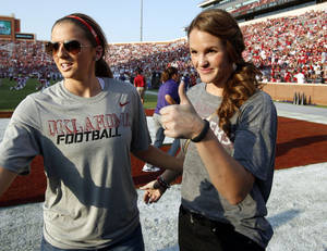 Photo - Mrs. Landry Jones (right) waits near the end zone before a college football game between the University of Oklahoma Sooners (OU) and the Kansas State University Wildcats (KSU) at Gaylord Family-Oklahoma Memorial Stadium, Saturday, September 22, 2012. At left is fellow basketball teammate Morgan Hook.  Photo by Steve Sisney, The Oklahoman <strong>STEVE SISNEY - THE OKLAHOMAN</strong>