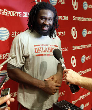 Photo - Defensive end Charles Tapper speaks to the media during the college football press conference for the University of Oklahoma Sooners (OU) at Gaylord Family-Oklahoma Memorial Stadium in Norman, Okla., Monday, Aug. 26, 2013. Photo by Steve Sisney, The Oklahoman