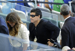 Photo - Argentine soccer legend Diego Armando Maradona leaves the tribune during the first half of the group F World Cup soccer match between Argentina and Iran at the Mineirao Stadium in Belo Horizonte, Brazil, Saturday, June 21, 2014. (AP Photo/Sergei Grits)