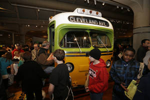 photo - Visitors to The Henry Ford in Dearborn, Mich.,  board the Rosa Parks bus, Monday, Feb. 4, 2013. Earlier in the day the Rosa Parks' 100th birthday commemorative postage stamp was unveiled at the museum.(AP Photo/Carlos Osorio)