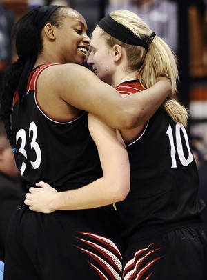 Photo - Cincinnati seniors Jeanise Randolph, left, and Kayla Cook embrace after they finish playing in the second half of an NCAA college basketball game against Connecticut in the quarterfinals of the American Athletic Conference women's basketball tournament, Saturday, March 8, 2014, in Uncasville, Conn. Connecticut won 72-42. (AP Photo/Jessica Hill)