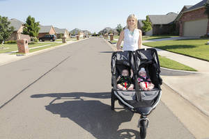 Photo - Melissa Miller takes her twins, Jackson and Harper, for a stroll in south Oklahoma City's Talavera neighborhood.  Photos by David McDaniel, The Oklahoman