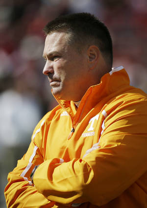 Photo - Tennessee head coach Butch Jones watches his team prior to an NCAA college football game against Alabama in Tuscaloosa, Ala., Saturday, Oct. 26, 2013. (AP Photo/Dave Martin)