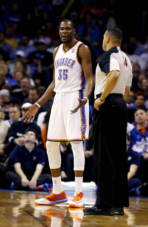 Photo - Oklahoma City Thunder's Kevin Durant (35) reacts to being called for a foul in the first half of an NBA basketball game where the Oklahoma City Thunder play the Los Angeles Lakers at the Chesapeake Energy Arena in Oklahoma City, on March 13, 2014.  Photo by Steve Sisney The Oklahoman