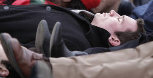 Photo - FILE - In this Jan. 17, 2011 file photo, Virginia Tech shooting survivor Colin Goddard participates in a lie-in during a rally protesting gun violence in Richmond, Va. The divide between those who favor gun control and those who don't has existed for decades, separating America into hostile camps of conservative vs. liberal, rural vs. urban. As the nation responds to the massacre of 20 children and six adults in Newtown, Conn., the gulf has rarely felt wider than now. (AP Photo/Steve Helber, File)