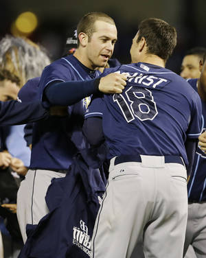 Photo - Tampa Bay Rays' Evan Longoria, left, and Ben Zobrist (18) celebrate after defeating the Texas Rangers 5-2 in their American League wild-card tiebreaker baseball game Monday, Sept. 30, 2013, in Arlington, Texas.(AP Photo/Tony Gutierrez)