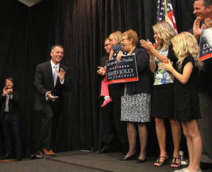 Photo - Republican David Jolly heads to the stage to thank his supporters Tuesday, March 11, 2014, at the Sheraton Sand Key Resort, in Clearwater Beach, Fla. Jolly edged Democrat Alex Sink in a Tampa-area House district that had been held by the late Rep. Bill Young, a 42-year Republican who died in October of cancer. (AP Photo/The Tampa Tribune, Andy Jones)  ST. PETERSBURG OUT; LAKELAND OUT; BRADENTON OUT; MAGS OUT; LOCAL TV OUT; WTSP CH 10 OUT; WFTS CH 28 OUT; WTVT CH 13 OUT; BAYNEWS 9 OUT; THE TAMPA BAY TIMES OUT; LAKELAND LEDGER OUT; BRADENTON HERALD OUT; SARASOTA HERALD-TRIBUNE OUT; WINTER HAVEN NEWS CHIEF OUT