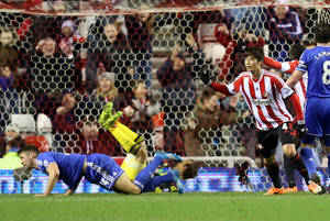 Photo - Sunderland's Ki Sung Yueng, right, celebrates his goal during their English League Cup quarter final soccer match against Chelsea at the Stadium of Light, Sunderland, England, Tuesday, Dec. 17, 2013. (AP Photo/Scott Heppell)