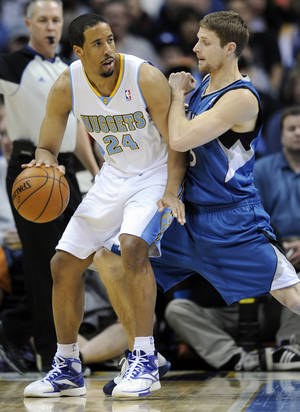 photo - Denver Nuggets guard Andre Miller (24) is pressured by Minnesota Timberwolves guard Luke Ridnour (13) during the first quarter of an NBA basketball game on Thursday, Jan. 3, 2013, in Denver. (AP Photo/Jack Dempsey)