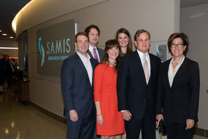Photo - Shown at the opening of the Samis Family Education Center are Mike Samis and his family, pictured from left: front row, Fred Fellers III, Carter (Samis) Fellers, Mike and Karen Samis; and back row, Kent Regens and Katharine (Samis) Regens.  PHOTO PROVIDED