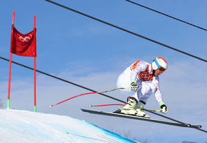 Photo - United States' Bode Miller jumps during a men's downhill training run for the Sochi 2014 Winter Olympics, Saturday, Feb. 8, 2014, in Krasnaya Polyana, Russia. (AP Photo/Alessandro Trovati)