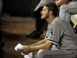 Photo - Chicago White Sox starting pitcher Chris Sale watches the ninth inning of a baseball game against the Houston Astros, Friday, June 14, 2013, in Houston. Sale pitched eight innings in the Astros 2-1 win. (AP Photo/Pat Sullivan)