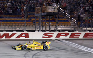 Photo - Ryan Hunter-Reay crosses the finish line to win the Indy Car series event in Newton Iowa Saturday July 12, 2014. (AP Photo/Justin Hayworth)