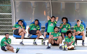 Photo - Brazil's players from left: Daniel Alves, Thiago Silva, Neymar, Oscar, Fred, Marcelo, Dante, and Hernanes, attend a training session in Belo Horizonte, Brazil, Monday, June 24, 2013. Brazil will play one of the semifinals of the Confederations Cup against Uruguay on Wednesday. (AP Photo/Andre Penner)