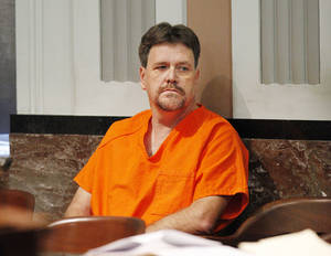 Photo - Michael Elder sits in the courtroom for a hearing at the Oklahoma County Courthouse in Oklahoma City Thursday, March 7, 2013. Elder is charged in the shooting death of his son-in-law. Photo by Paul B. Southerland, The Oklahoman