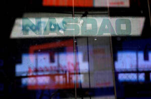 Photo - Electronic billboards are reflected in the windows of Nasdaq in New York, Thursday, Aug. 22, 2013. Nasdaq halted trading Thursday because of a technical problem, the latest glitch to affect the stock market. (AP Photo/Seth Wenig)